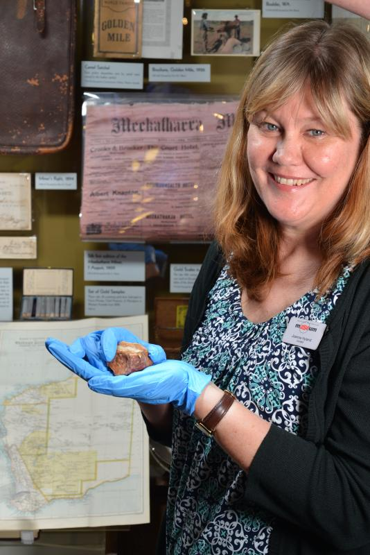 WA Museum History Curator Joanne Hyland holding a quartz gold-bearing nugget