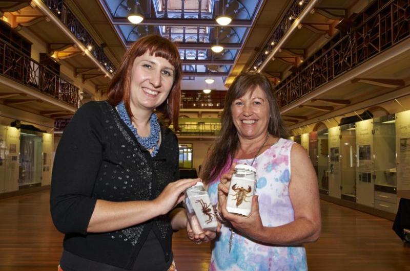 Jo holding a specimen jar with Dr Amber Beavis