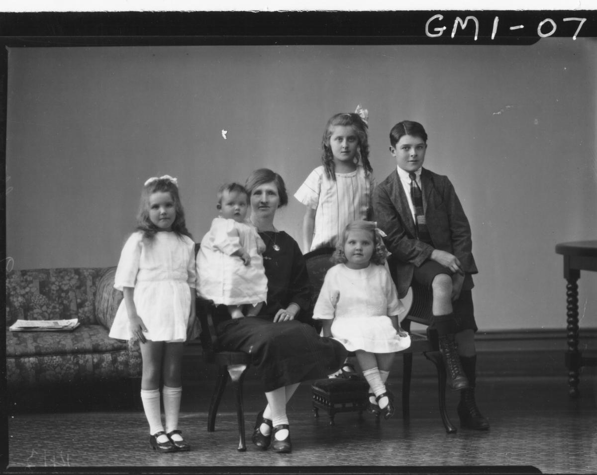 Family portrait woman and five children, F/L, Mrs. 'Ogg'.