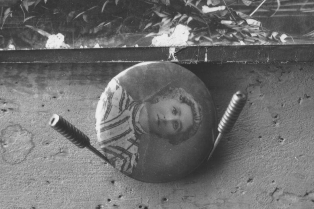 Board pinned minature copy of woman, H/S,'Mutson'.