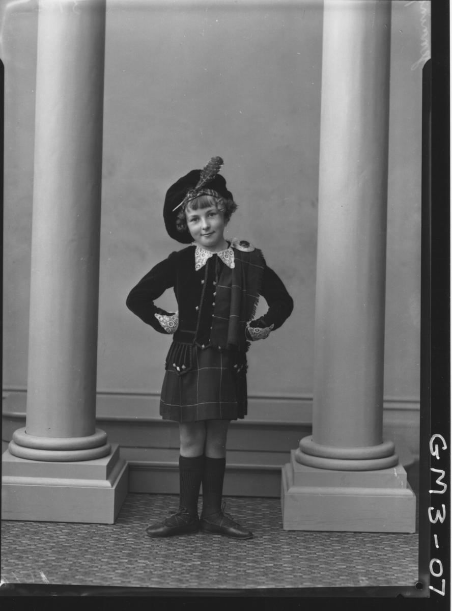 Portrait of child in Highland dancing outfit, F/L, 'Jennings'.