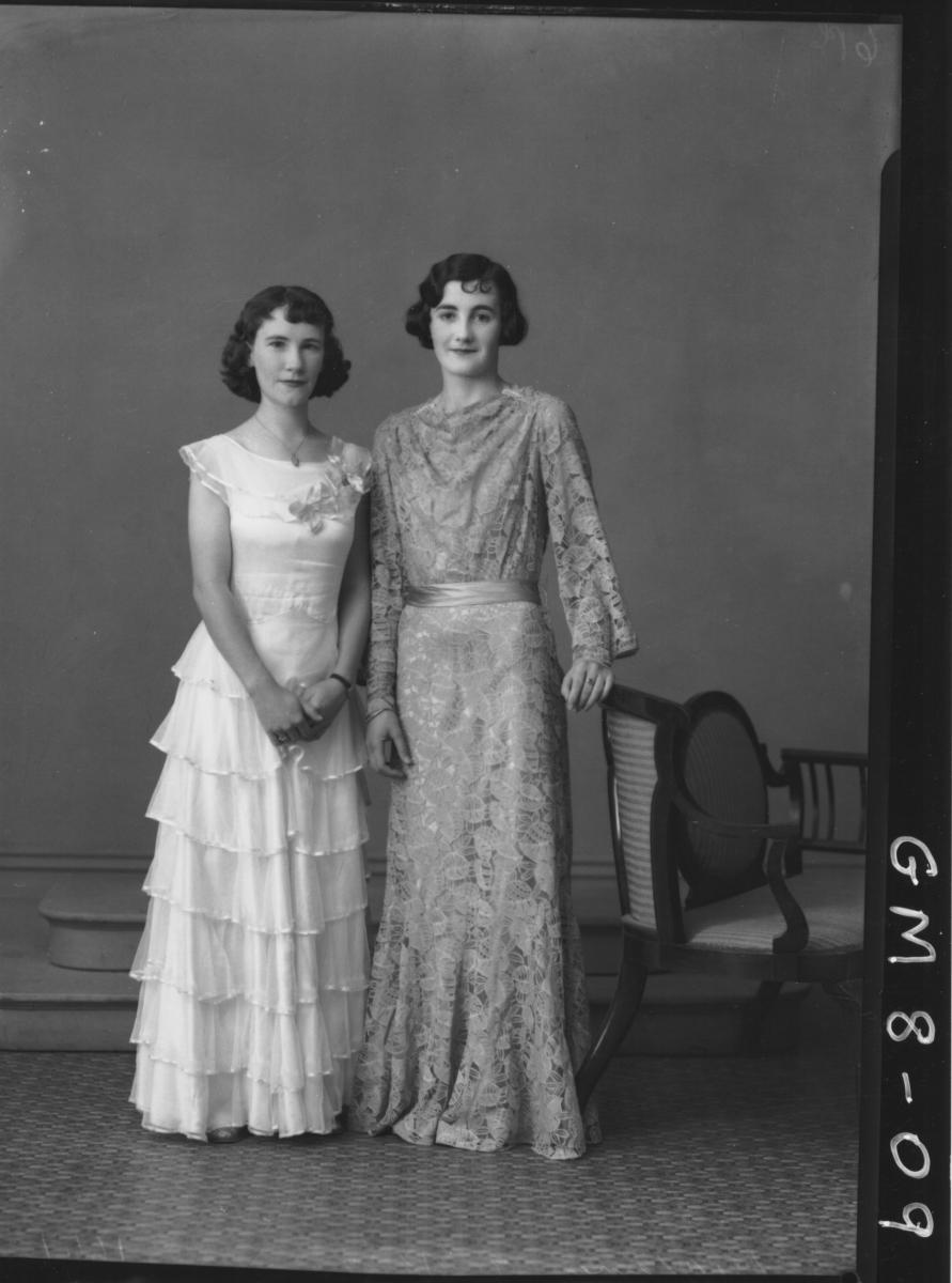 Portrait of two women in evening dress, F/L Kilderry and Virg.