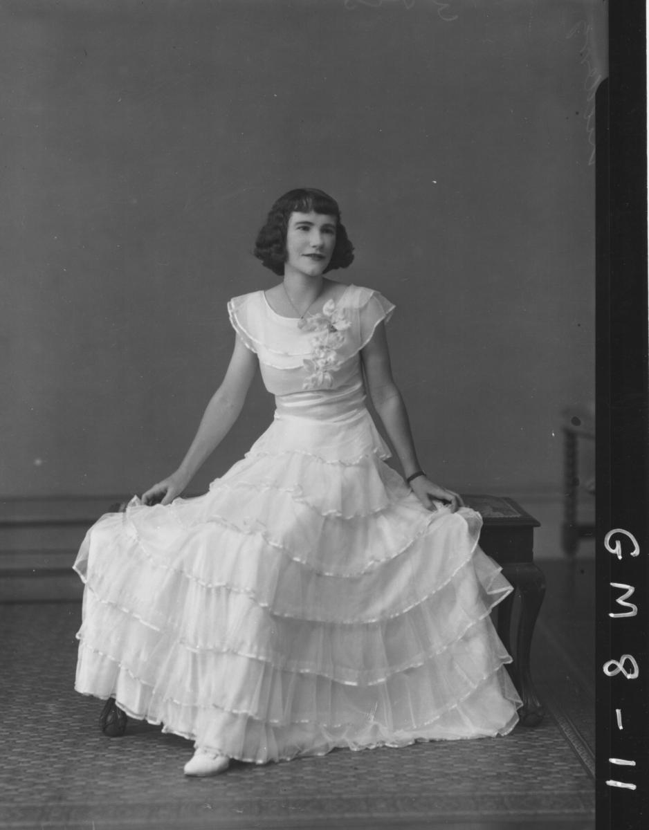 Poartrait of young woman in evening dress, F/L Killderry.