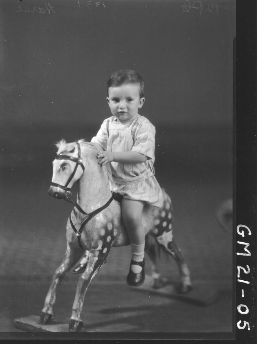 portrait of small child on rocking horse F/L, Harse
