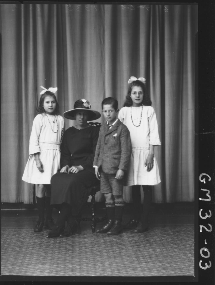 portrait of woman and three children, F/L Smith