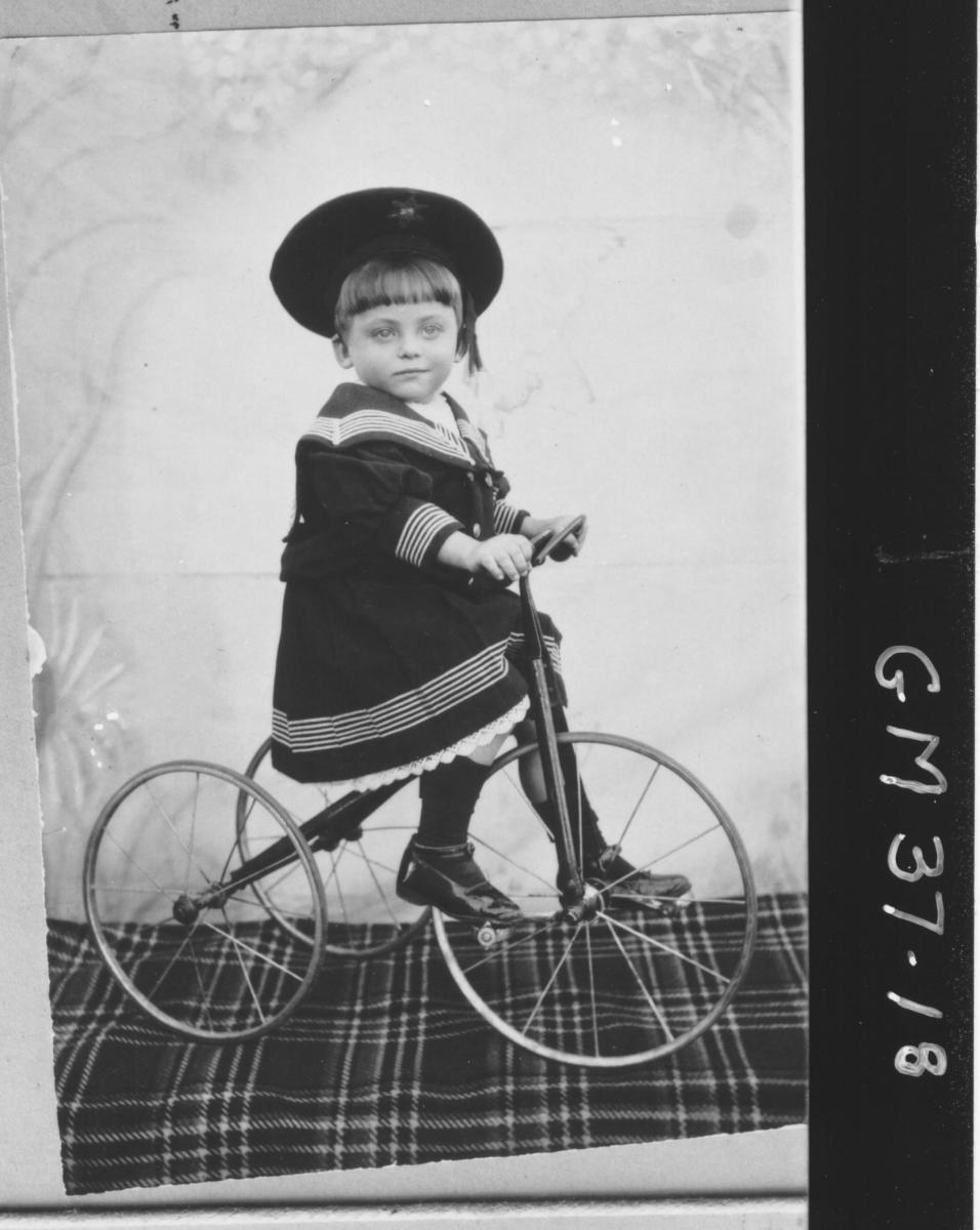 copy of early portrait, young boy on tricycle, Pritchard