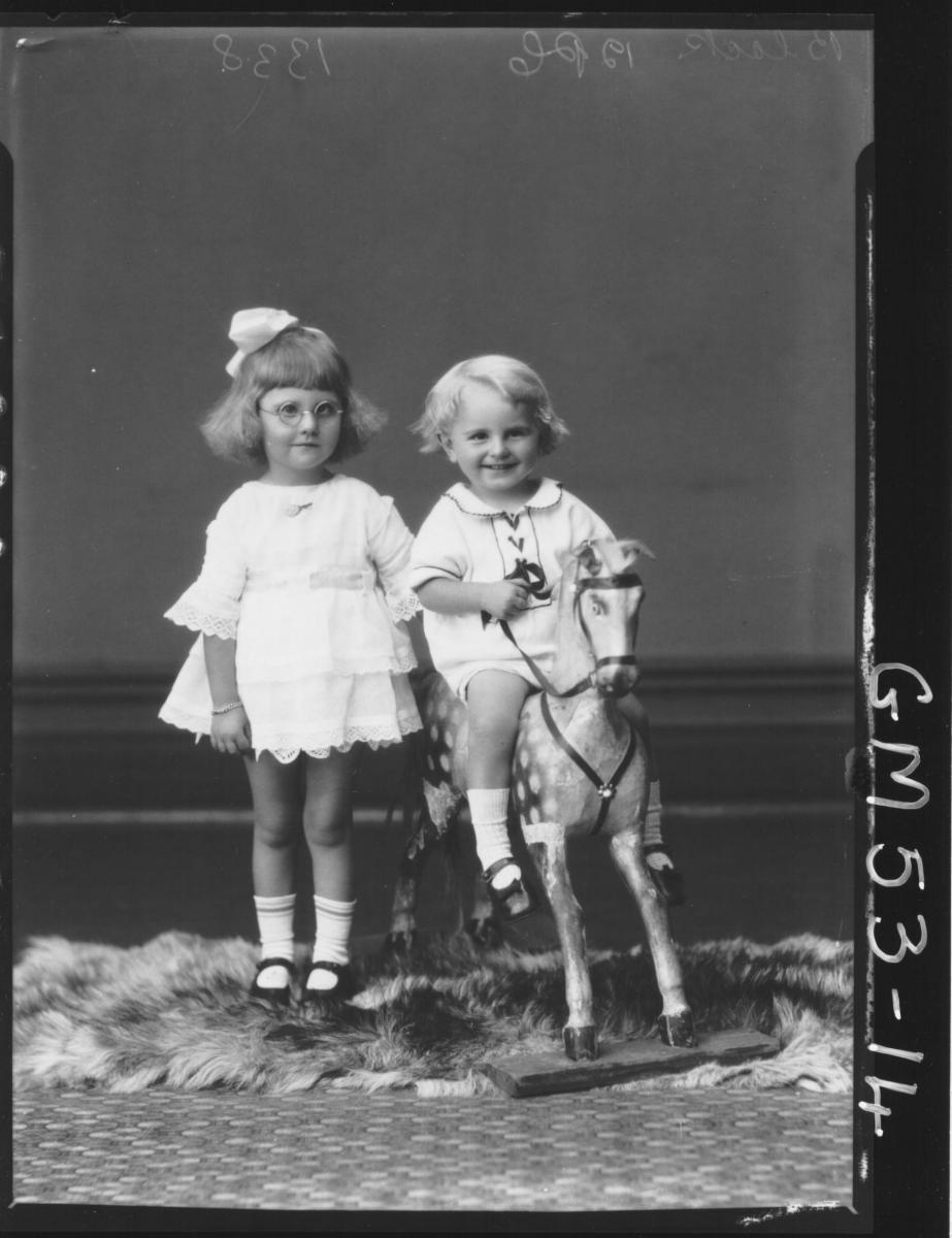 PORTRAIT OF TWO CHILDREN AND ROCKING HORSE, F/L BLACK