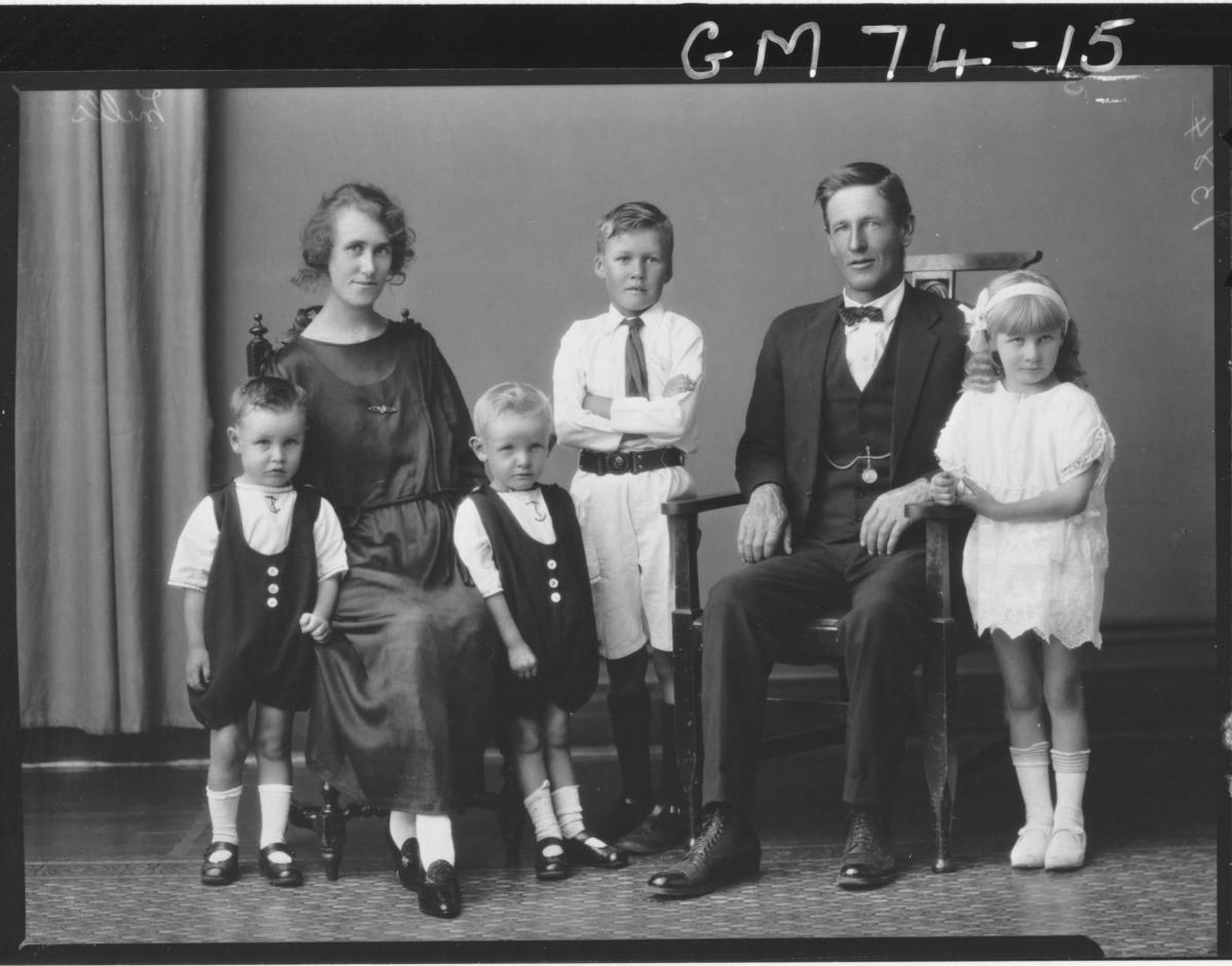 PORTRIAT OF WOMAN, MAN AND FOUR CHILDREN, MILLS