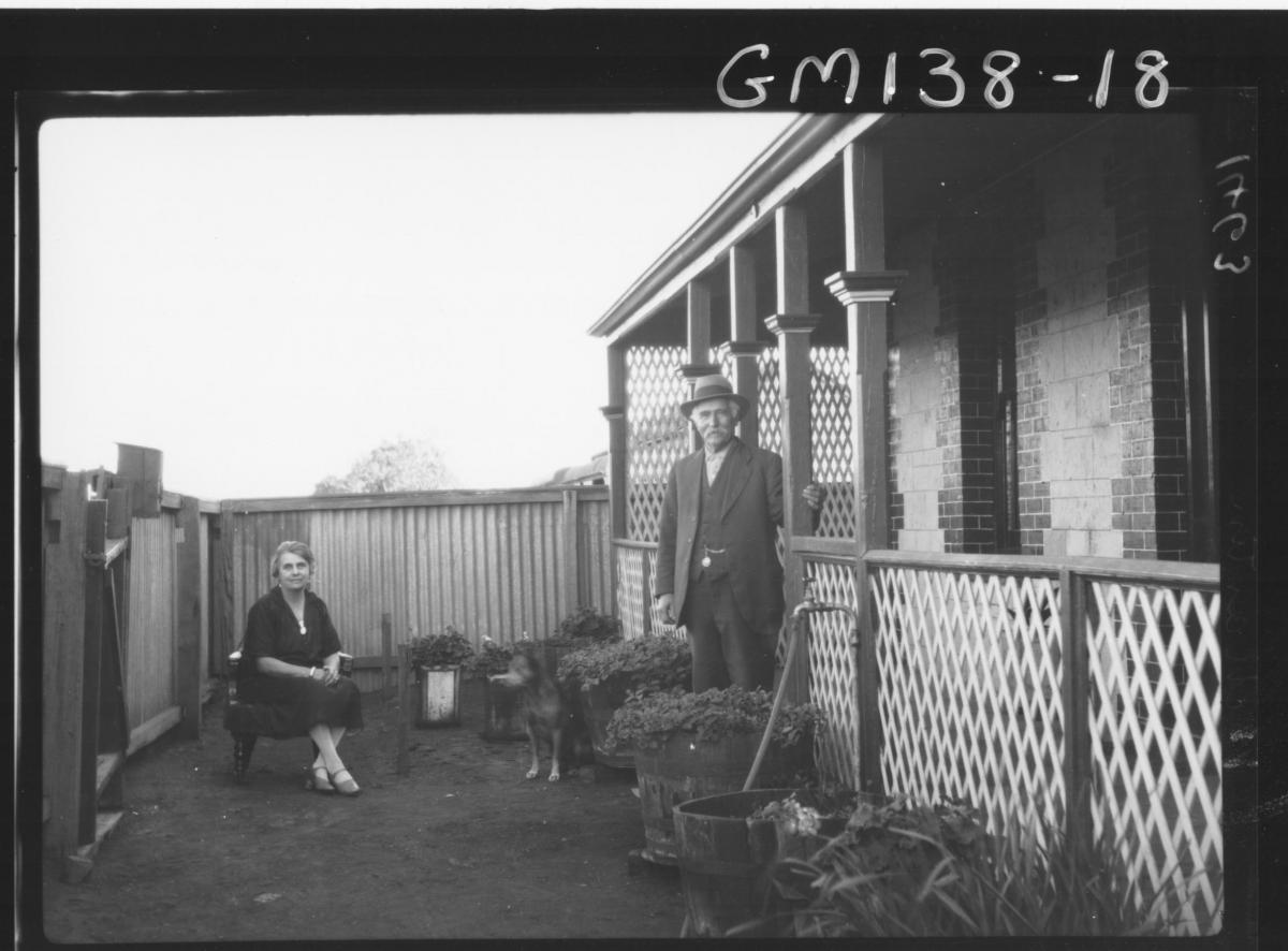Man and woman outside house 'Martin'