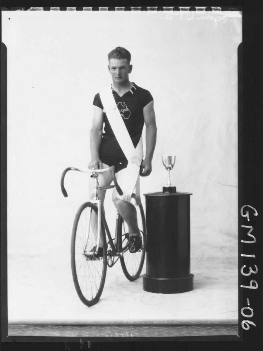 Portrait of cyclist with bike and cup 'Egan'
