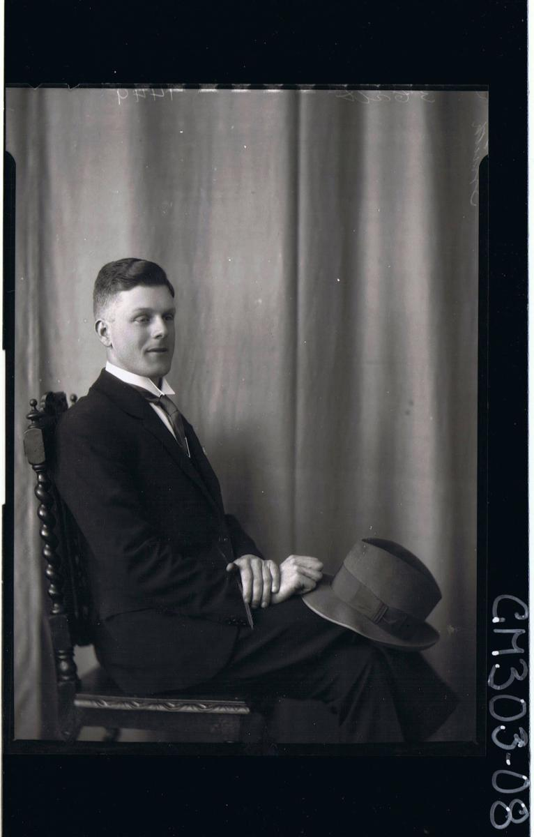 3/4 Portrait of man seated, wearing suit, holding hat, side view; 'Smith'