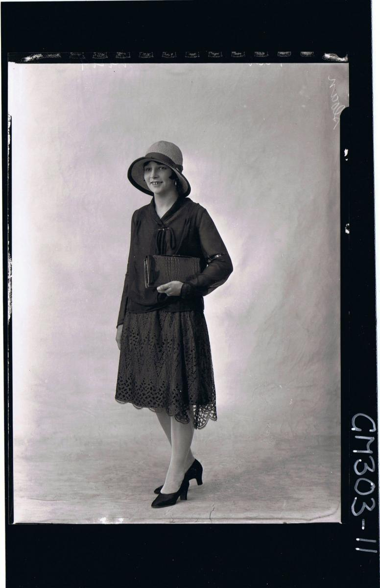 1/2 Portrait of elderly woman wearing day dress; 'Mathews' (passport)