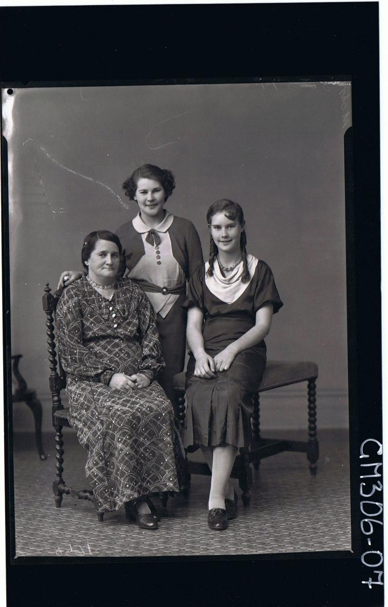 F/L Portrait of elderly woman seated, teenage girl seated wearing 3/4 length pleated dress, young woman standing; 'Mohr' see 306-11