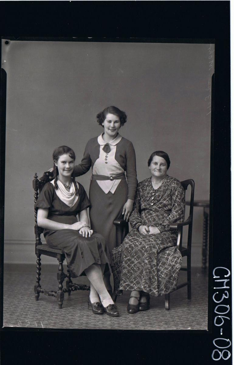 F/L Portrait of elderly woman seated wearing long dress,teenage girl seated,young woman standing,wearing 3/4 dress'Mohr'