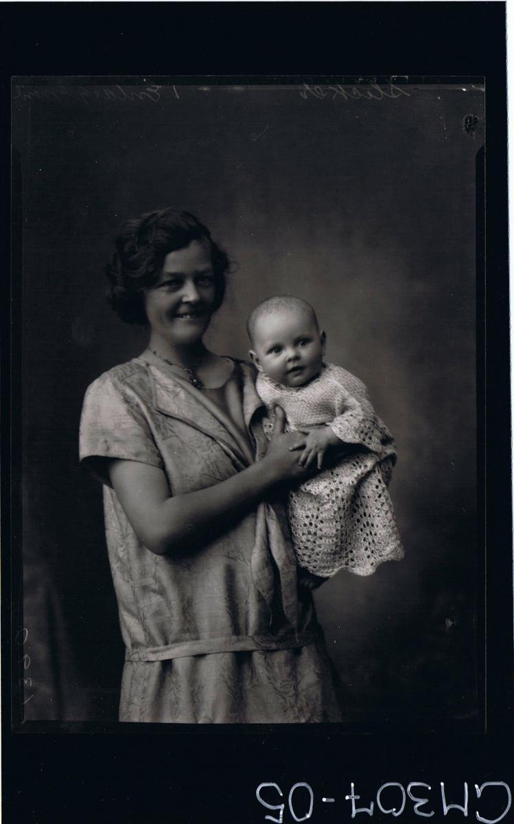 1/2 Portrait of woman standing holding baby; 'Schliker'