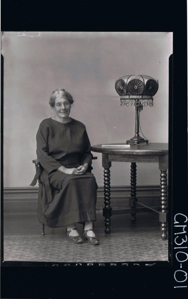 F/L Portrait of elderly woman seated, wearing a long dress; 'Martin'