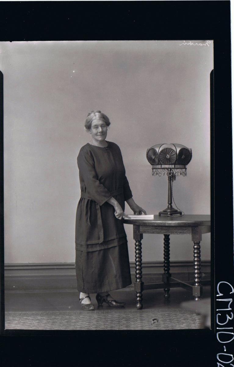 F/L Portrait of elderly woman standing wearing a long dress; 'Martin'
