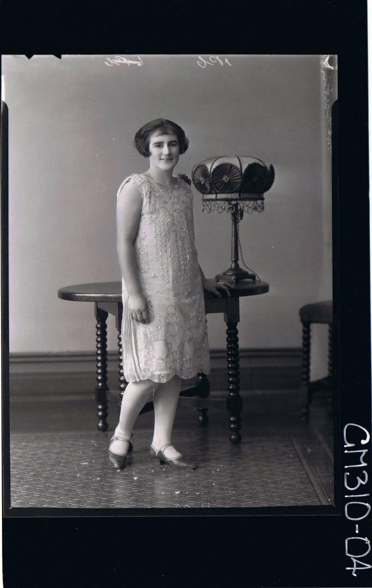 F/L Portrait of woman standing wearing knee length dress; 'Martin'