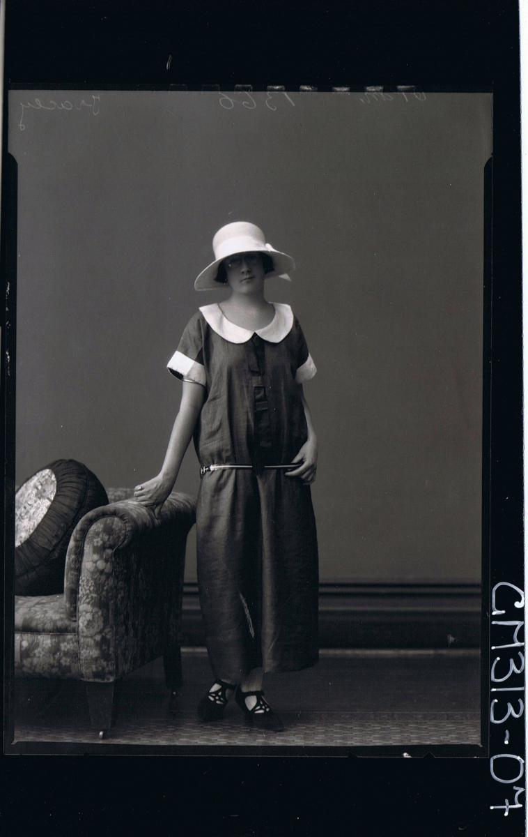 F/L Portrait of woman standing wearing ankle length dress and hat 'Tracey'