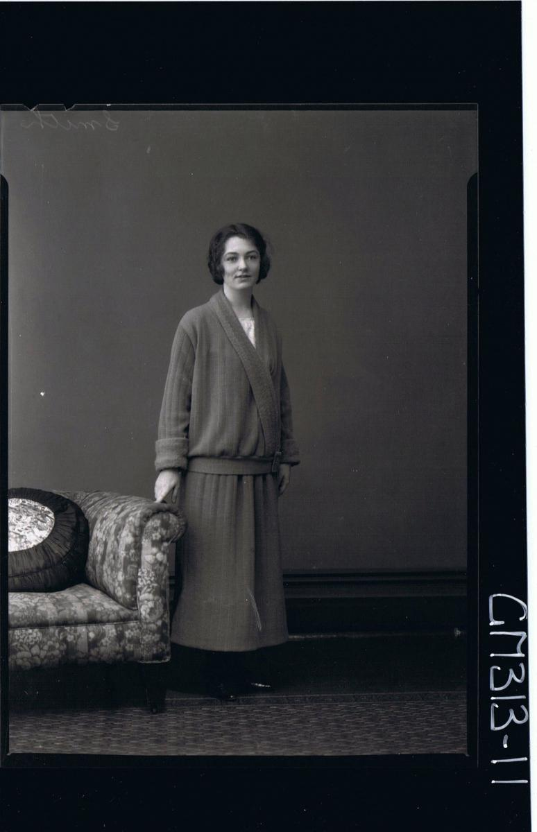 F/L Portrait of woman standing wearing 3/4 length skirt with matching jacket 'Smith'