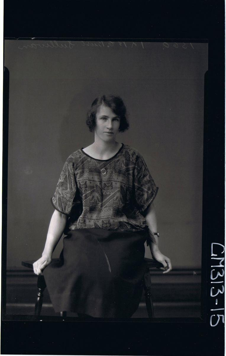 3/4 Portrait of woman seated wearing three quarter length skirt and patterned top 'Sullivan'