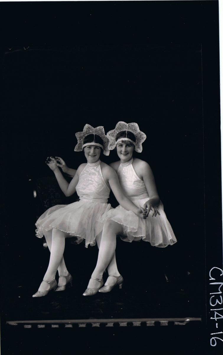 F/L Portrait of two women seated, wearing fancy dress costumes  'McCahon'