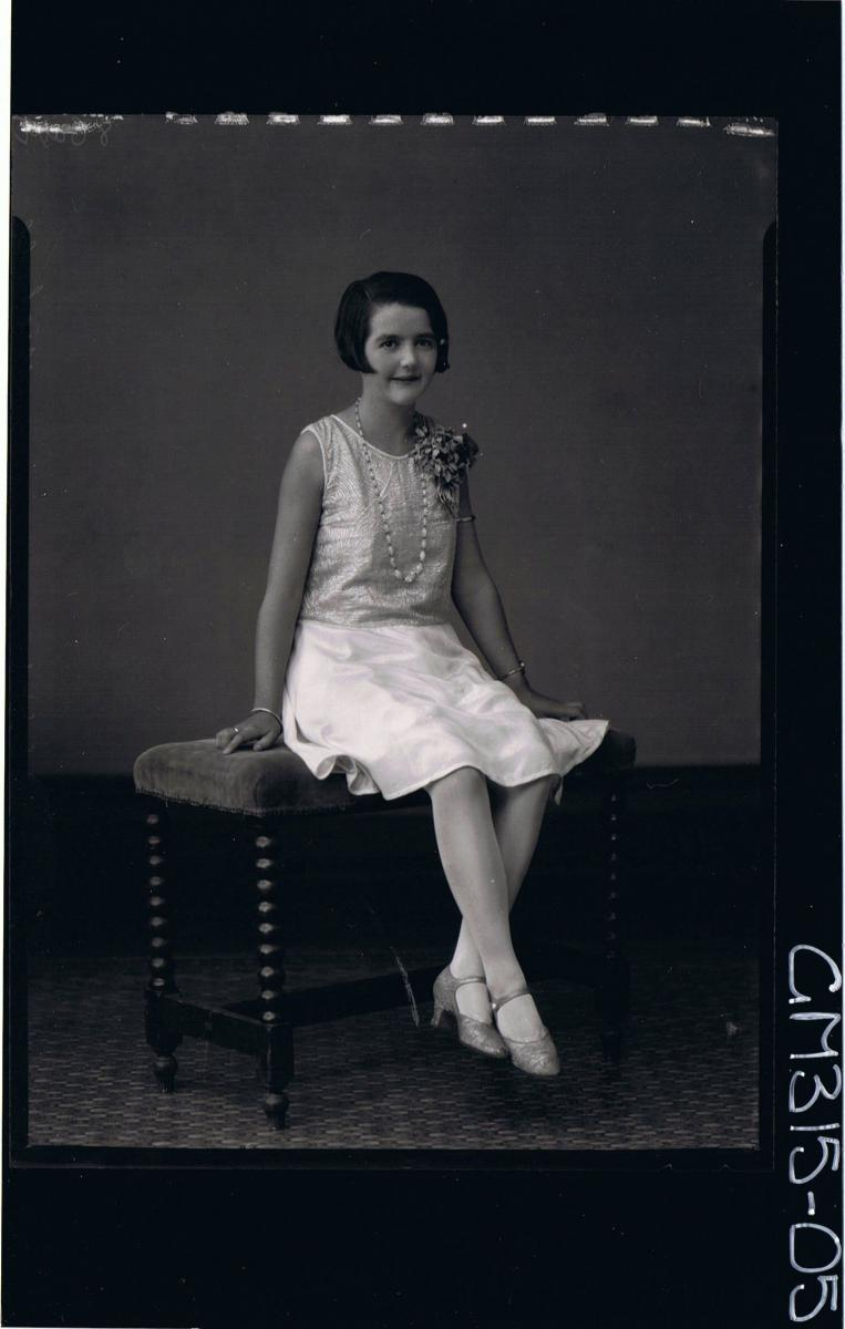 F/L Portrait of woman seated wearing satin knee length dress and corsage 'Michell'