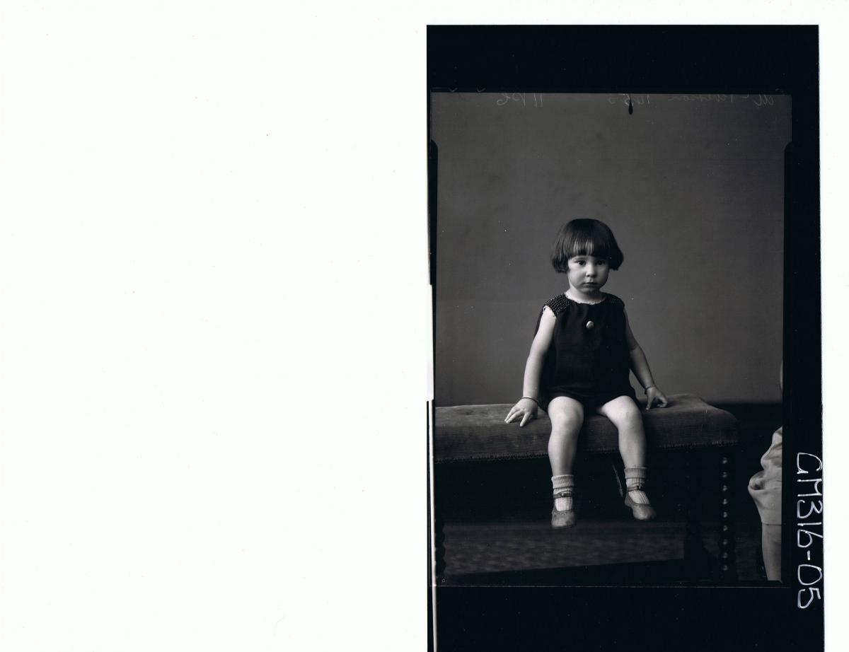 F/L Portrait of girl child seated wearing short dress 'McPherson'
