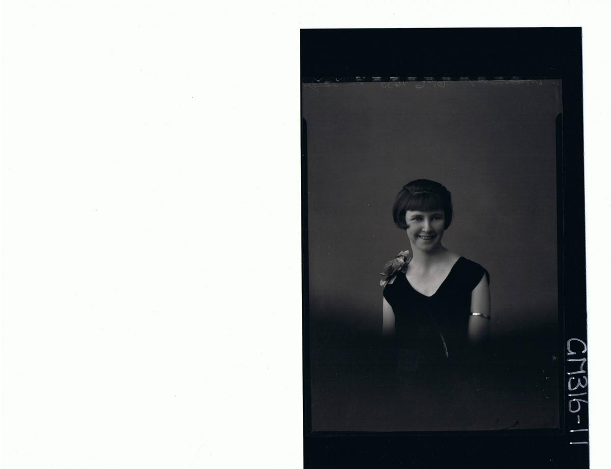 H/S Portrait of woman wearing velvet dress with flowers on shoulder 'McIntyre'
