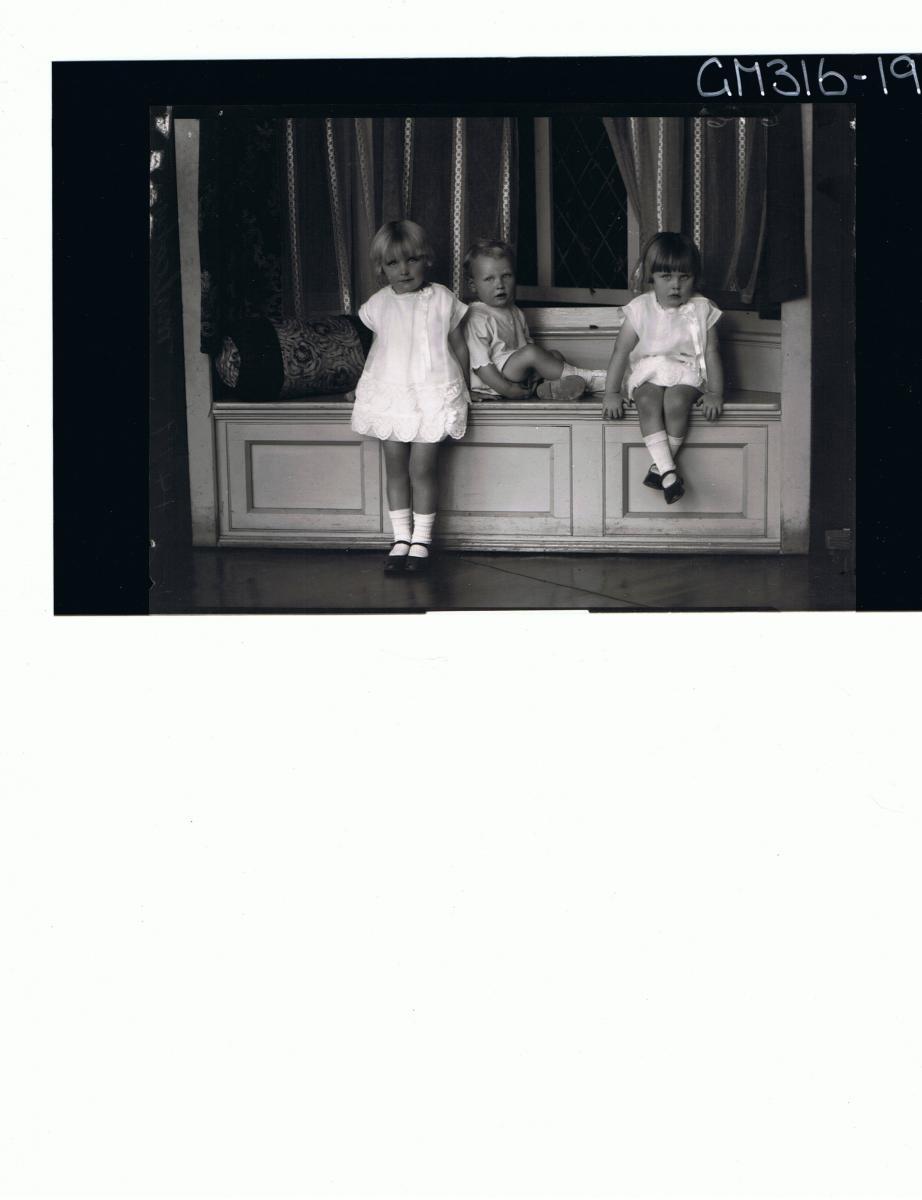 F/L Portrait of 3 children, girl standing wearing short dress,girl seated wearing short dress, boy seated 'Mulcahy'
