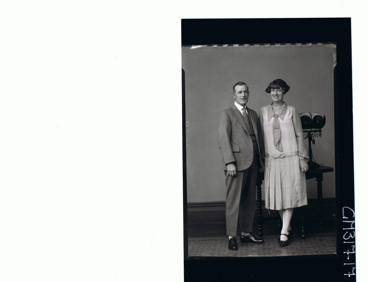 F/L Portrait of man standing wearing three piece suit, woman standing, wearing 3/4 length dress; 'Morrow'