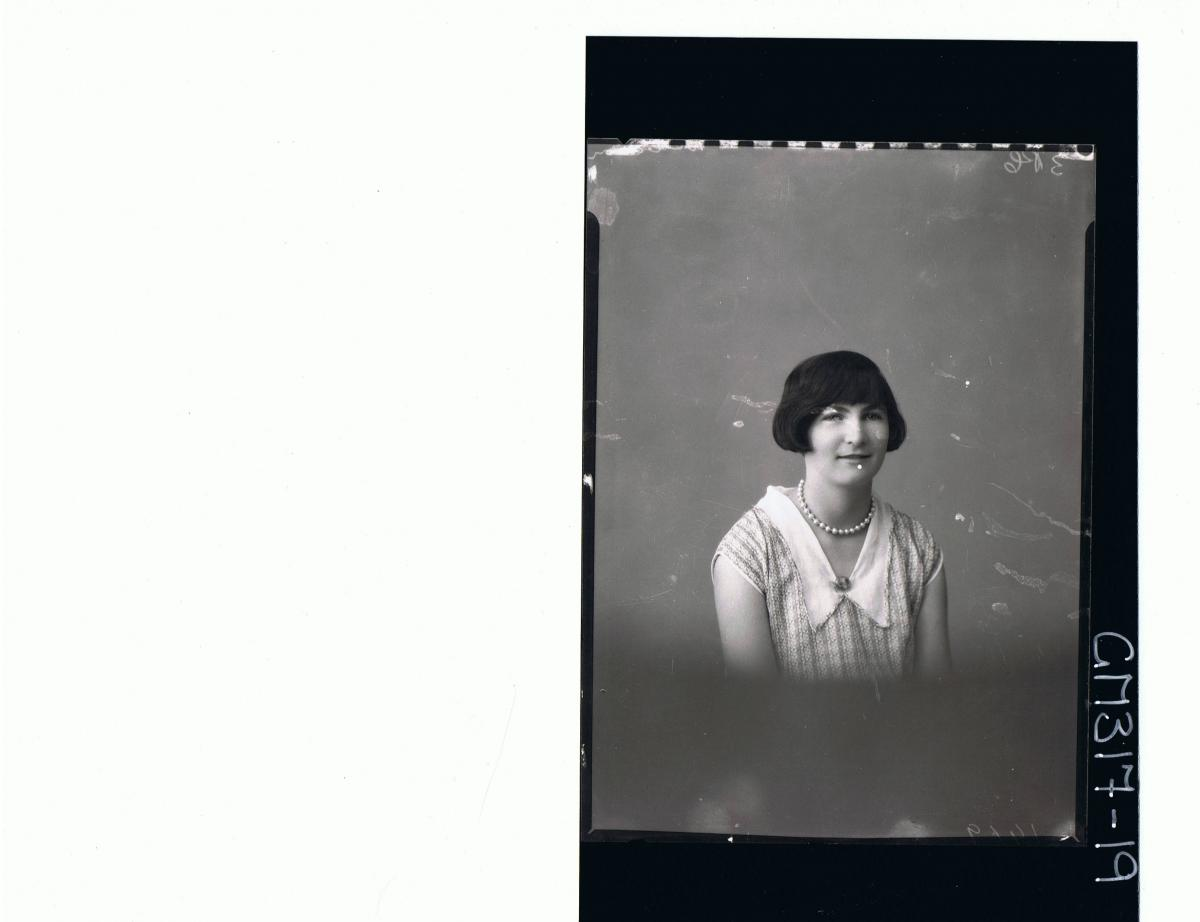 H/S Portrait of woman wearing patterned dress; 'McCahon'