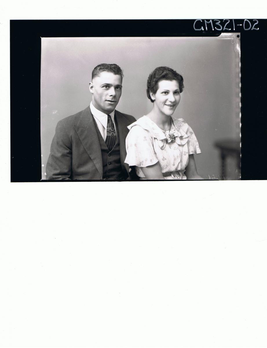 1/2 Portrait of man wearing three piece suit, woman wearing patterned day dress; 'Myers'