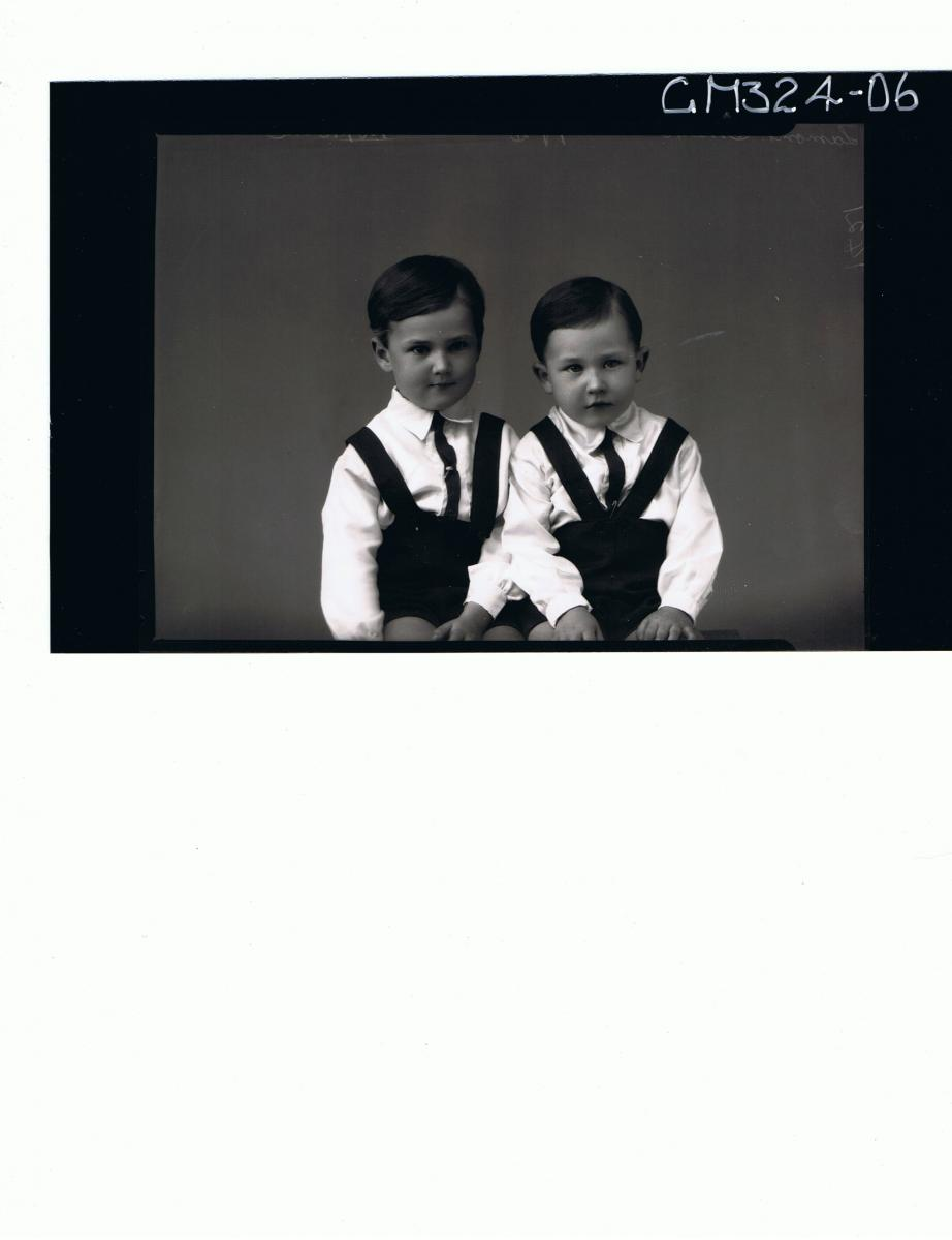 1/2 Portrait of 2 male children seated, wearing shirts, ties, shorts with braces; 'Lamont-Smith'