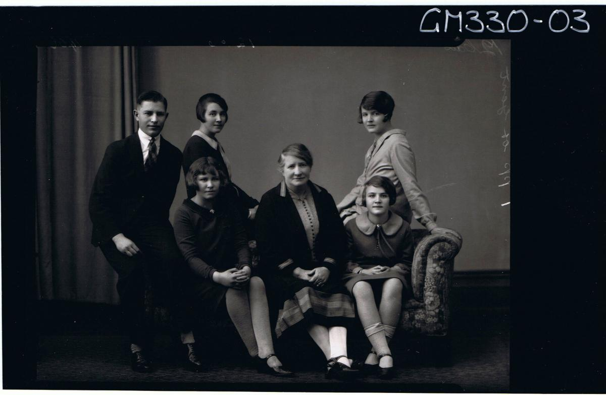 F/L Group Portrait of elderly lady, girl,young woman and young man seated,2 young women seated on back of couch'Buckman'