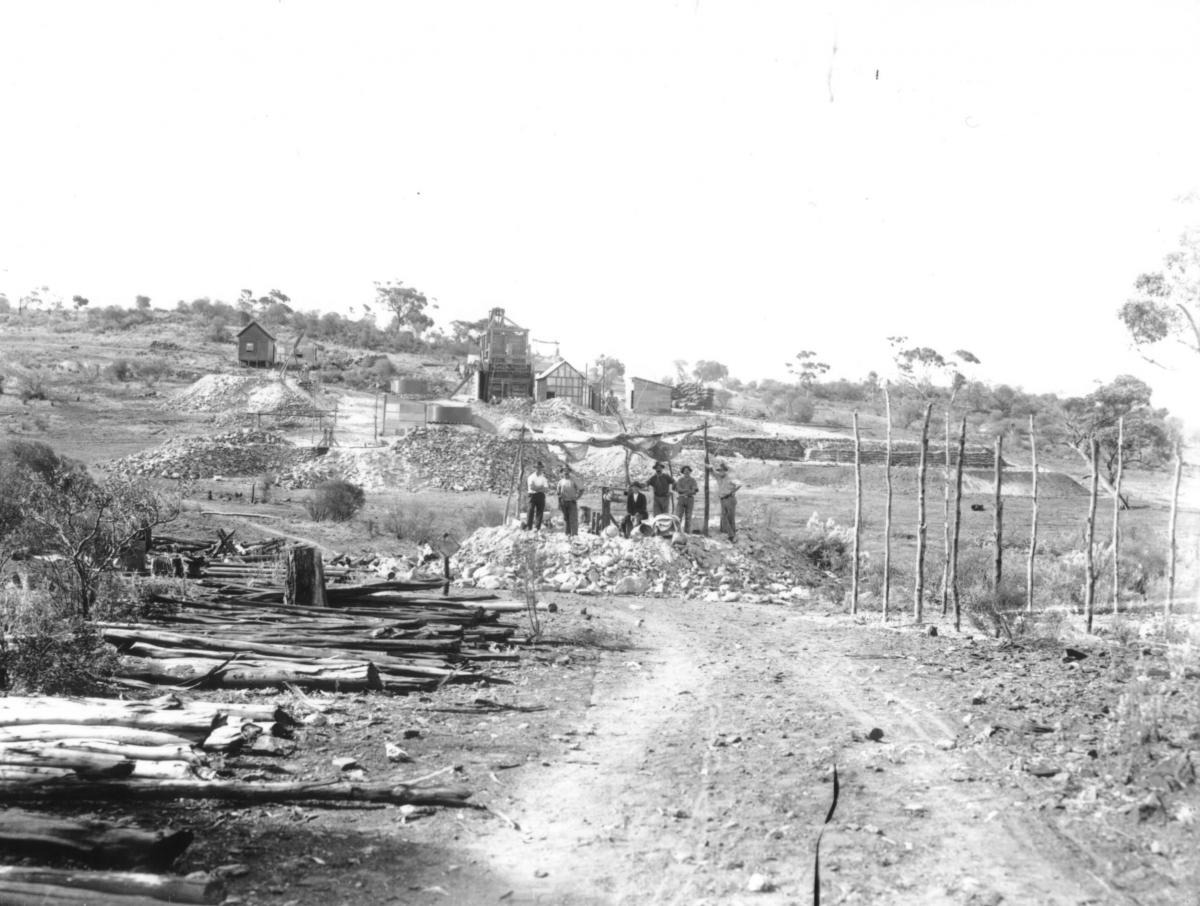 Small Gold Mine and Miners at Mt. Monger. 'This is the Proprietary Gold Mine - Charlie Hunt and McMahon (Mine employed 14 men). Prospector, Arthur Starr, Later of Starr and Garter Hotel Hannan Street Kalgoorlie, lived in little house for years, and built on another room, as some only had dirt floors. In 1945, J. Cunneen and Edgar Smith took over McMahon's Mine and crushed for the Public, at Huntingtons Mill, they treated sands.  They struck a big patch of gold and sunk another shaft over the hill'.