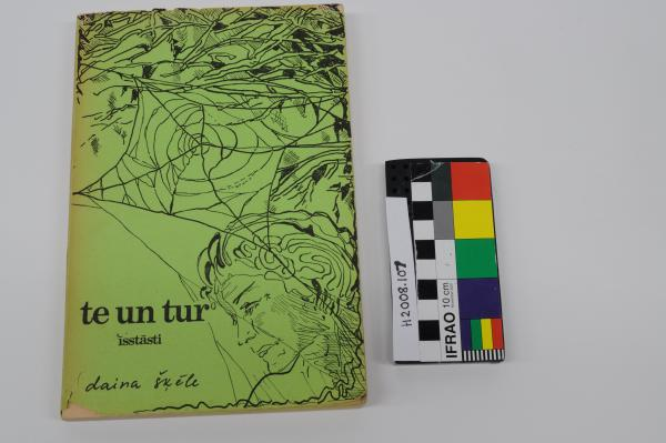 BOOK, Latvian 'Te un tur isstasti' (Here and There) by Daina Skele, green detachable cover, and ticket