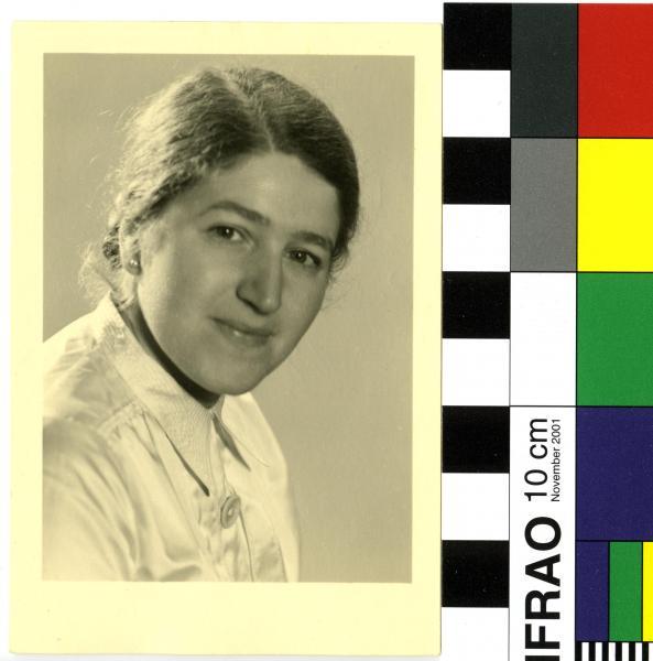 PHOTOGRAPH, b&w, studio passport style, woman smiling in satin shirt, handwritten 'Mamma's Passbild 1938'