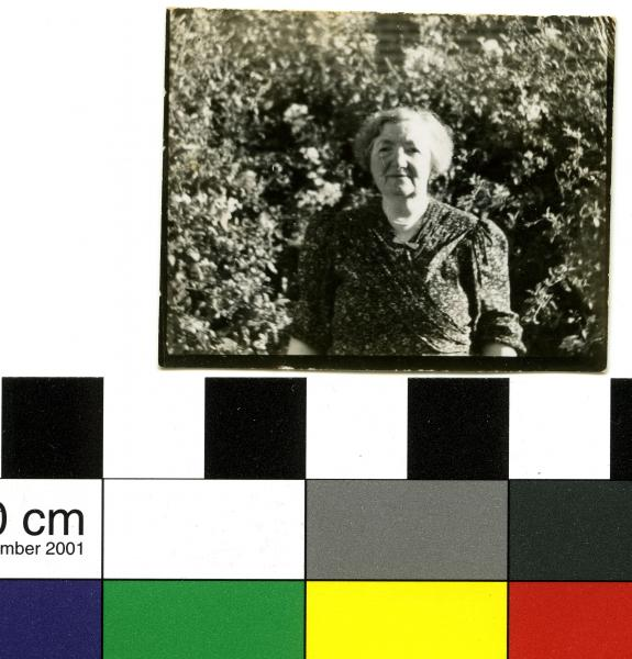 PHOTOGRAPH, b&w, small, elderly woman in garden wearing floral dress, 419 Rokeby Rd, Subiaco, 1946