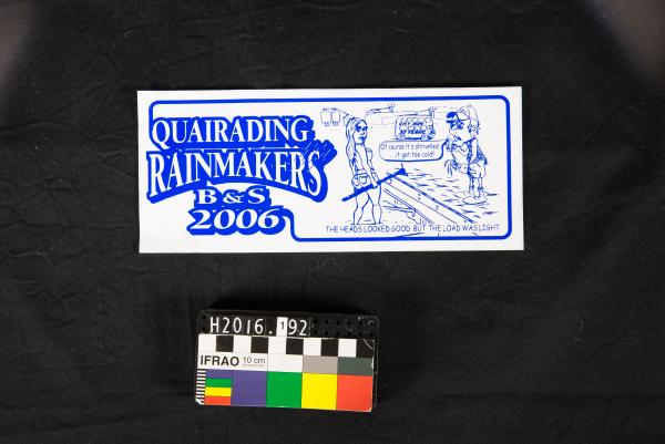 STICKER, blue & white, 'QUAIRADING RAINMAKERS B&S 2006', cartoon of woman and man
