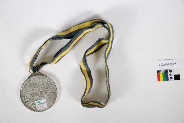 MEDAL, 'ADVANCE AUSTRALIA AWARD/ BEN LEXCEN', circular silver metal, green ribbon wih  yellow stripes