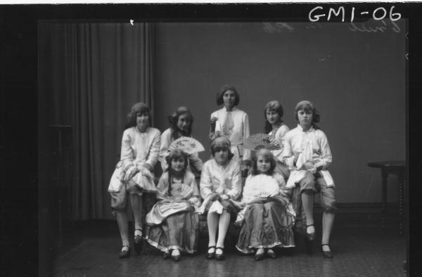 Eight young people in costume from theatre group,'O'Niel'.