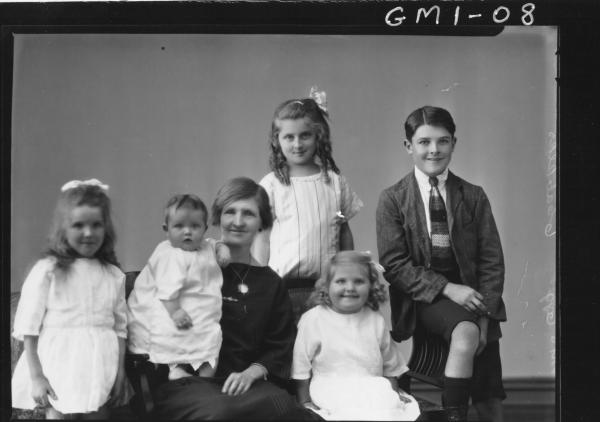 Family portrait woman and five children, H/S, Mrs 'Ogg'.