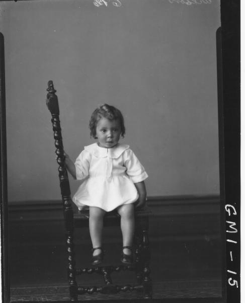 Portrait of a child in dress sitting on chair, F/L,'Wislon'.