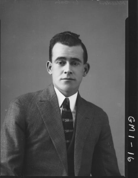 Portrait of a man in suit, H/S,'Wheedon'.