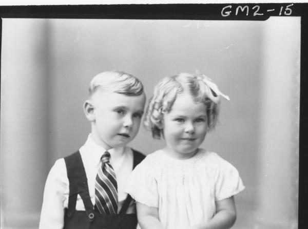 Portrait of dressed up young boy and girl, H/S, 'Jenkins'.