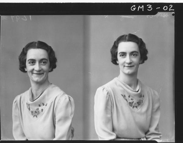 Two portrait poses of a woman, H/S, 'Isaacs'. In long sleeved embroidered dress.