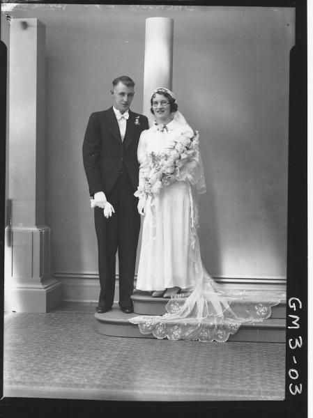 Portrait of bride and groom, F/L, 'Jackson'. Including studio column props.