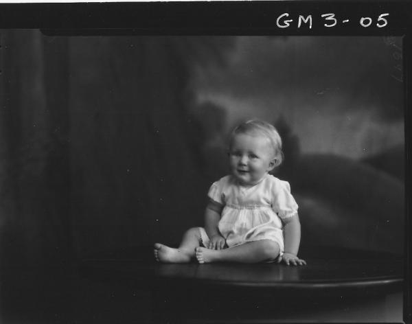 Portrait of young child, F/L, 'Jensen'. Sitting on table.