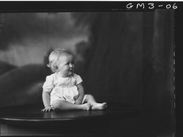 Portrait of young child, 'Jensen' sitting on table, F/L.
